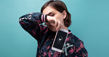 woman posing with an iphone in front of her face