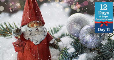 Santa figurine in the snow banner